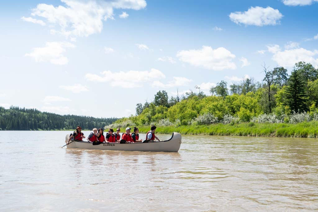 Metis Crossing A group of people on a canoe 1
